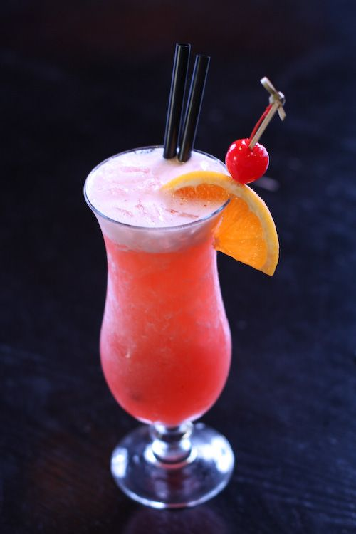 Bahama Mama - ¾ oz Coconut Rum (Malibu), ¾ oz Banana Liqueur (Hiram Walker), 1 oz Spiced Rum (Captain Morgan), 1.5 oz Orange Juice, 2.5 oz Pineapple Juice, 2-4 dashes (1-2 Tbs) Grenadine, ¼ cup crushed ice, Garnish: Orange/Pineapple wedge, 1 Maraschino Cherry (optional)... Combine all the ingredients and mix them in a cocktail shaker. Serve in a cocktail glass. Garnish with Orange/Pineapple wedge