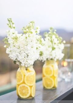 Lemon slices in ball jar with baby's breath flowers.
