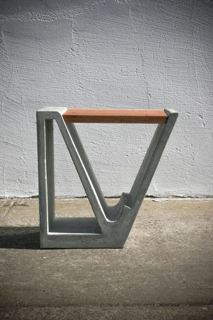a concrete and wood multipurpose piece of furniture design milk cement furniture