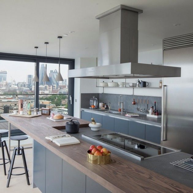 The semi professional kitchen incorporates stainless steel, a chef's tap, Gaggenau appliances and cooker hood, and a Falcon range cooker. Basaltina stone worktops sit over lacquered cabinets with oak veneered interiors, whilst the breakfast bar sets itself apart with a timber, butcher's block style surface offering casual eating with views across the city.