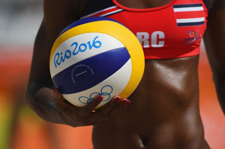 Karen Cope Charles of Costa Rica holds a ball during the Women's Beach Volleyball preliminary round Pool F match against Louise…