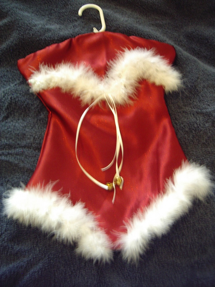 Red Satin trimmed with white boa feathers and ribbons with jingle bells. This is a Lingerie Keeper I made.  It opens along the bustline to a full length pocket. This could also be used as a Santa Stocking for hiding Christmas goodies.