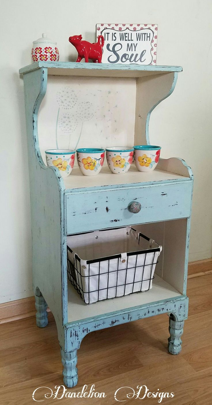 Vintage handmade cabinet turned into a farmhouse chic coffee bar Outside painted in Rustoleum Chalked paint Serenity Blue, heavily wet distressed Inside painted with Dutch Boy Antiqued Lace Whole piece waxed with natural, then dark wax giving it a very aged look.  Farmhouse chic, Rustoleum Chalked, coffee bar, Dutch Boy Chalky Finish
