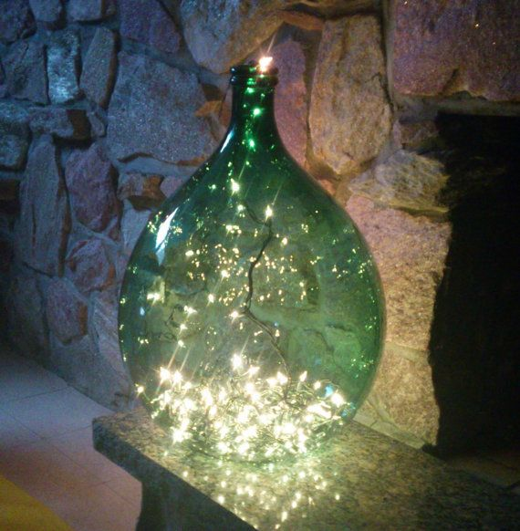 Originally used in wine making, use demijohn as quirky oversized vase or unique floor lamp! Handblown vintage dark green glass demi-john. The glass