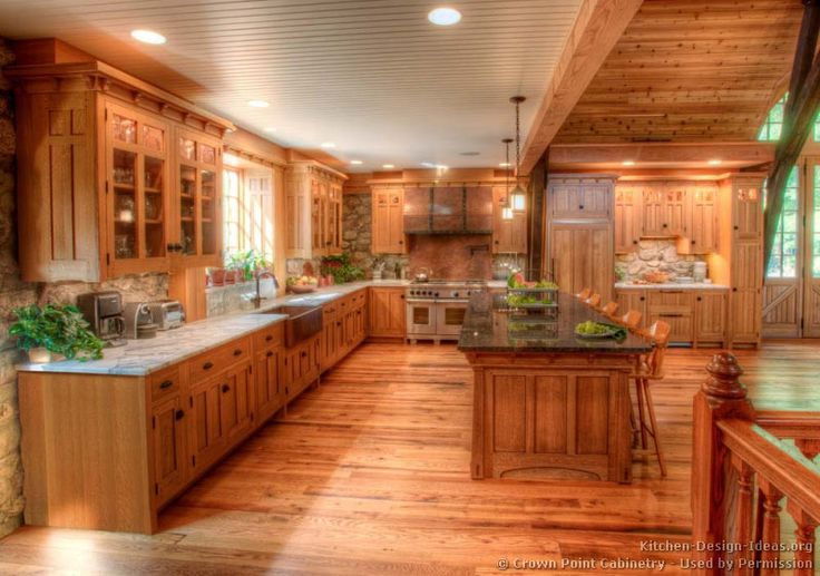 Kitchen of the day timber frame home craftsman cabinets for Craftsman log homes