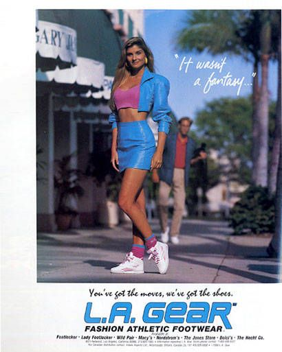 """If this L.A. Gear ad isn't indelibly burned into your brain, you simply did not pick up a fashion magazine in 1988. We may laugh now, but back then there was nothing sexier than being super-tan, super-fit, and showing it all off in a """"fashion athletic"""" turquoise leather skirt suit. The """"It wasn't a fantasy..."""" tagline is still perplexing (what, exactly, wasn't a fantasy?), but I kind of like that—makes you wonder if the answer is in the shoes. (March 1988)"""
