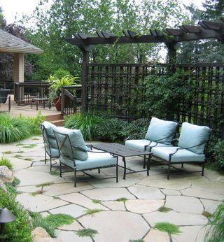 Flagstone patio with trellis/pergola combo.