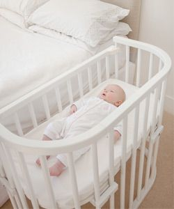 Babybay Bedside Cot: The BabyBay provides all the benefits of a co-sleeping environment with none of the perceived drawbacks as the cot securely attaches to the parents bed providing peace of mind that baby is safe within his or her own separate sleeping area.
