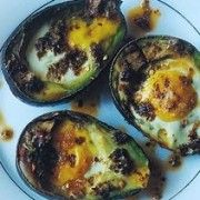 Why You Should Bake Your Eggs Inside An Avocado