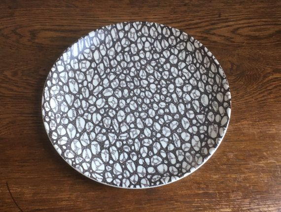 Poole Pottery Black Pebble dinner plate in good used condition. Diameter: 25.5cm.  No chips or cracks, there is maybe some slight wear to the pattern and there are some small brown marks to the underside.  Contact me for accurate postage costs to anywhere other than the UK.  I will always combine postage costs if possible. All of my items are sent Signed For and/or Tracked.