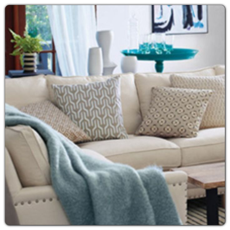 A cosy room with a splash of teal.