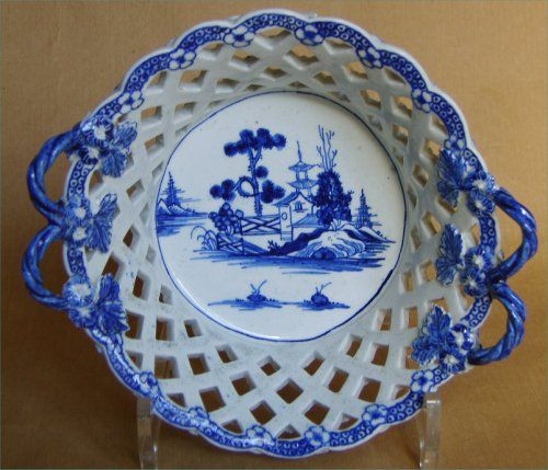 """A Derby blue and white  basket with double handles with flowers and leaves terminals and with an oriental garden scene painted  to the base. Lattice work sides with flowers at the intersections. Circa  1768   Width 6 3/4"""""""