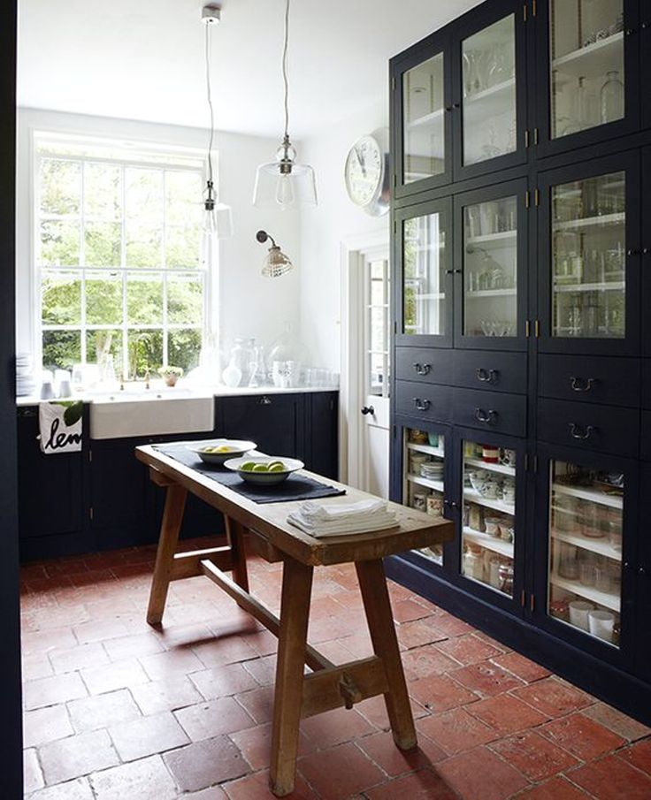 Throughout house: teracotta floors (rich and dark) with black cabinets & wooden counter tops  & shelves