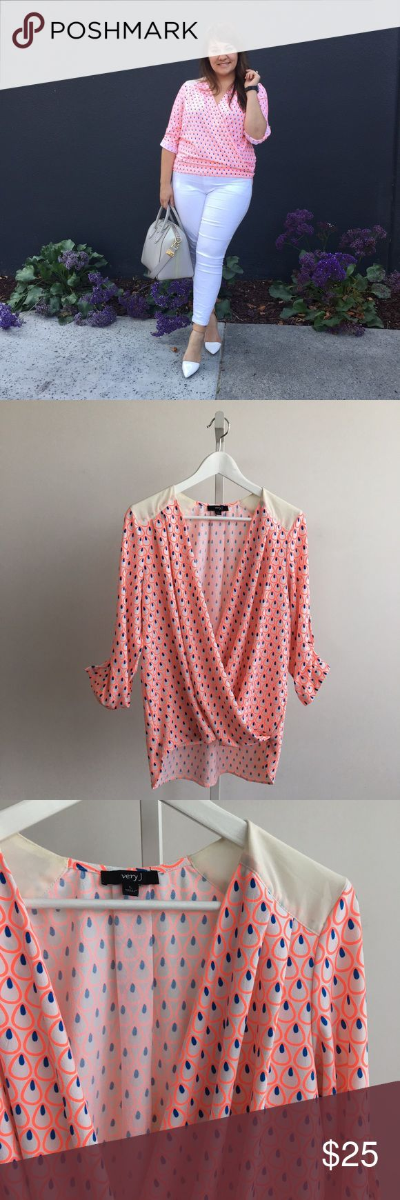 Bright Printed Faux Wrap Top Vibrant and flattering faux wrap top with a neon coral and blue design. Sleeves can be worn down or rolled up with button tab. Excellent used condition. Please carefully review each photo before purchase as they are the best descriptors of the item. My price is firm. No trades. First come, first served. Thank you! :) Very J Tops Blouses