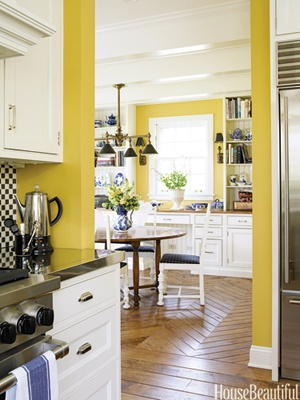 Yellow Kitchen    The walnut floor, hand-scraped to give it even more character, changes to a chevron pattern in the adjoining breakfast room. The same yellow paint, Benjamin Moore's HC10, unifies both rooms.