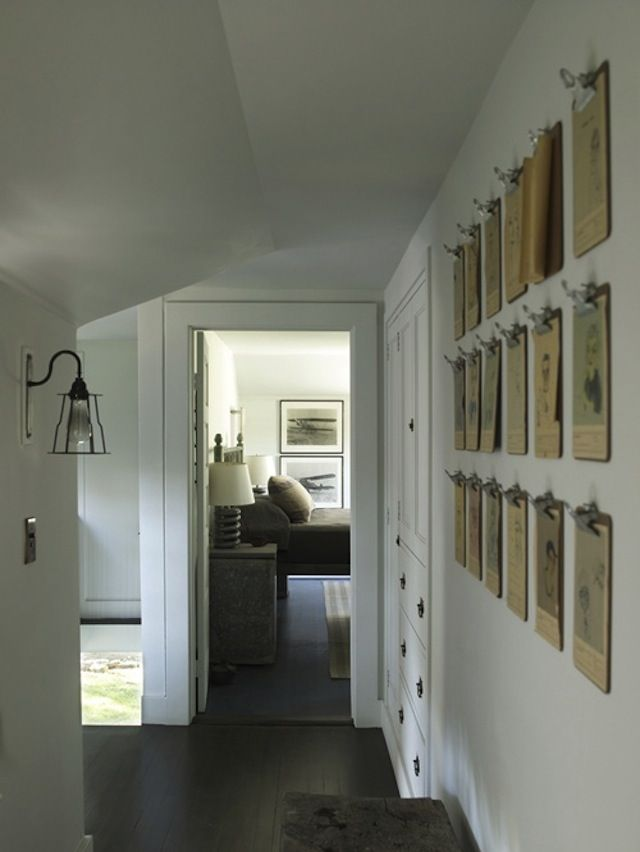 I love this idea. I have a stack of photos I can display this way and the perfect empty wall waiting for some art.Wall Art, Ideas, Display Photos, Elle Decor, Clipboards Art, Art Display, A Frames, Child Art, Kids Artworks