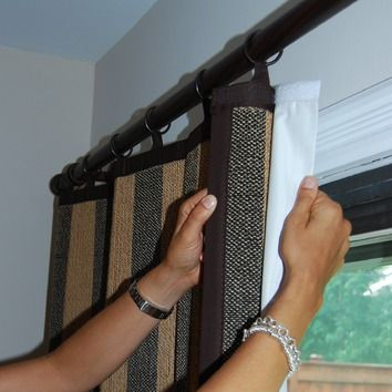 Attach blackouts to existing curtains with Velcro.