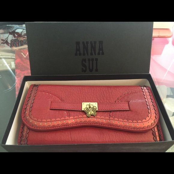 Anna Sui NWOT long wallet This has never been used! Really cute red wallet, lots of pockets and great detail. Authentic Anna Sui  Anna Sui Bags Wallets