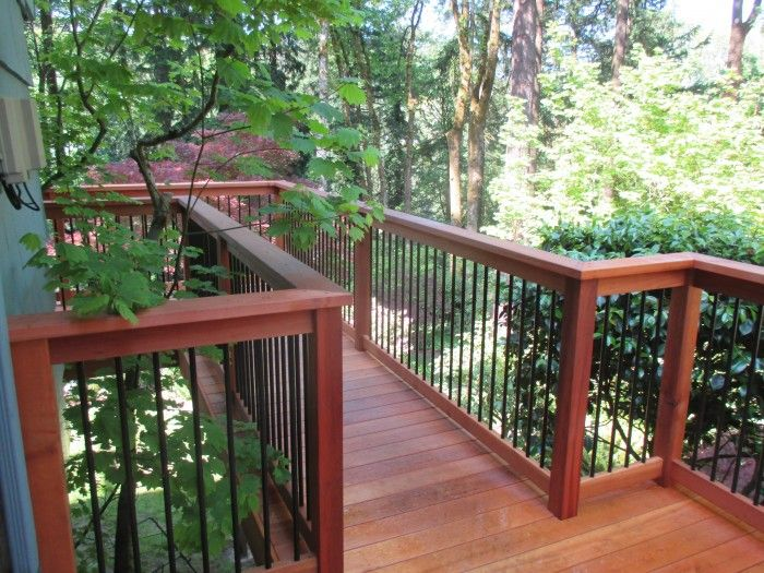 This deck has clear cedar for the decking and railing with black metal balusters. We stained it in Natural redwood color. Most people these days opt for tight knot cedar because it is much cheaper but this customer wanted the best, and he got it. This ...
