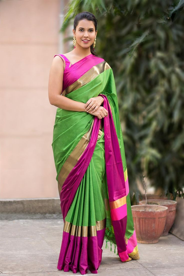 The Pantone color of the year green is here with a rockstar fuchsia to add drama to the saree. This cotton silk saree with pink and gold border against the enchanting green body of the saree is perfect for those wedding functions or even a simple cocktail hour. Pair her with traditional jewellery and amp up the wow factor.ACCOMPANIMENTS: All sarees are sold completely finished with falls (where required) and a free size underskirt. FABRIC: Saree – Soft cotton silkBorder – Magenta and dull…