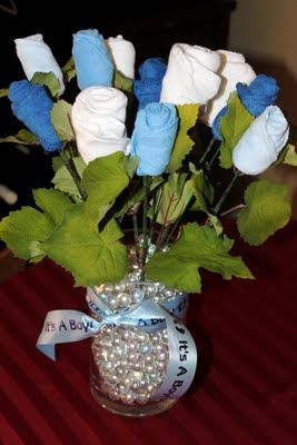 Instead of Diaper Cake - gonna use this idea if I ever have to throw a baby shower again!  Washcloth, sock and onesie bouquet!