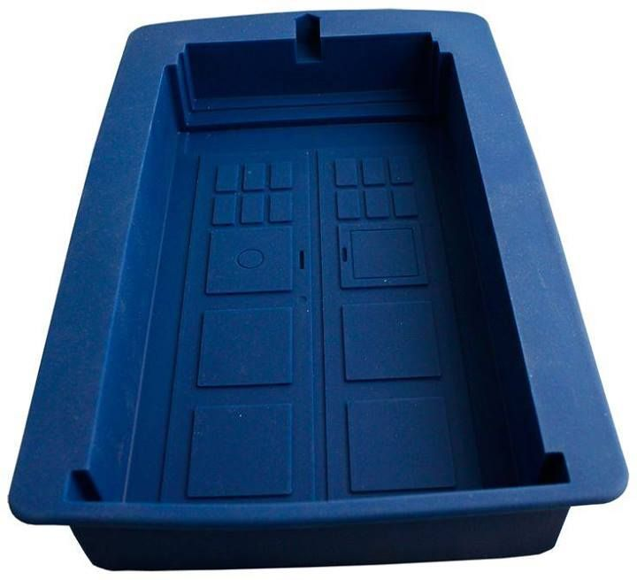 Dr. Who cake pan. I'd regenerate for this. Maybe if I can sneak one of the cards out of his wallet