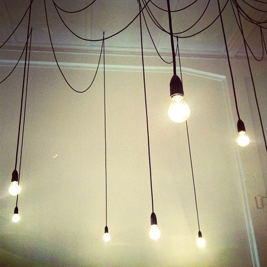 Hanging light bulbs on wires. Bedroom.