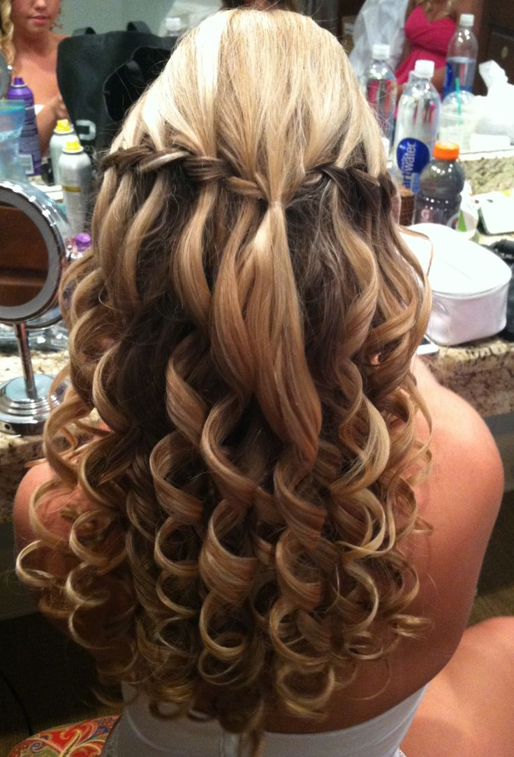 Wedding/prom hair. Waterfall braids with a bump and big curls