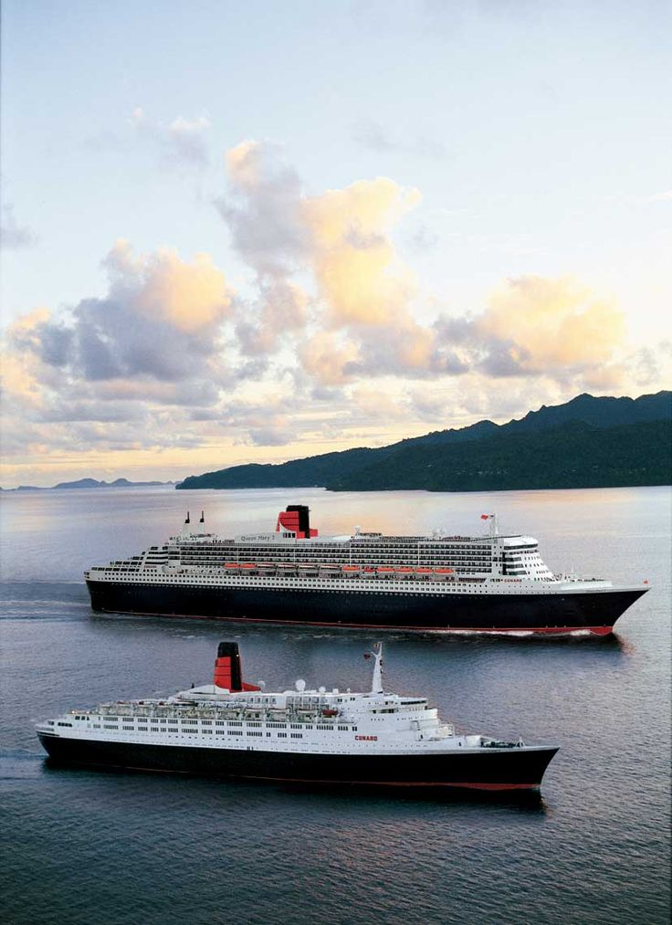 Queen Mary 2 and Queen Elizabeth 2 sailing side-by-side.