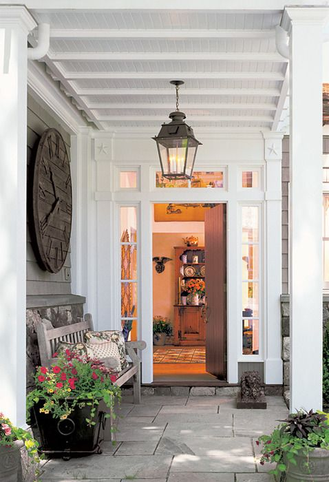 Welcoming porch!  Love the big clock.