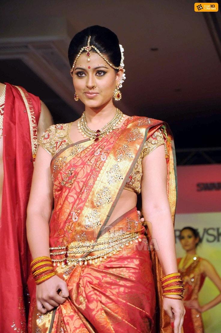 South Indian bride. Temple jewelry. Jhumkis.Classic red silk kanchipuram sari.Braid with fresh flowers. Tamil bride. Telugu bride. Kannada bride. Hindu bride. Malayalee bride.Sneha.