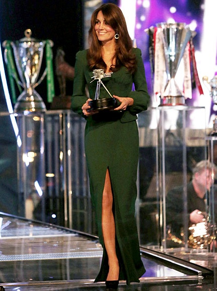 Kate, the Duchess of Cambridge, walks out to present Lord Sebastian Coe with the Lifetime Achievement Award during the BBC Sports Personality of the Year Awards show on Dec. 17, 2012. This was her first official appearance since leaving the hospital for morning sickness.