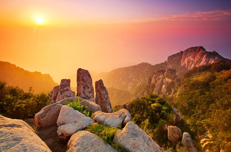 "The world famous sunrise of Mount Taishan, China. Mount Tai is one of the ""Five Great Mountains"". It is associated with sunrise, birth, and renewal, and is often regarded the foremost of the five. Mount Tai has been a place of worship for at least 3,000 years and served as one of the most important ceremonial centers of China during large portions of this period."