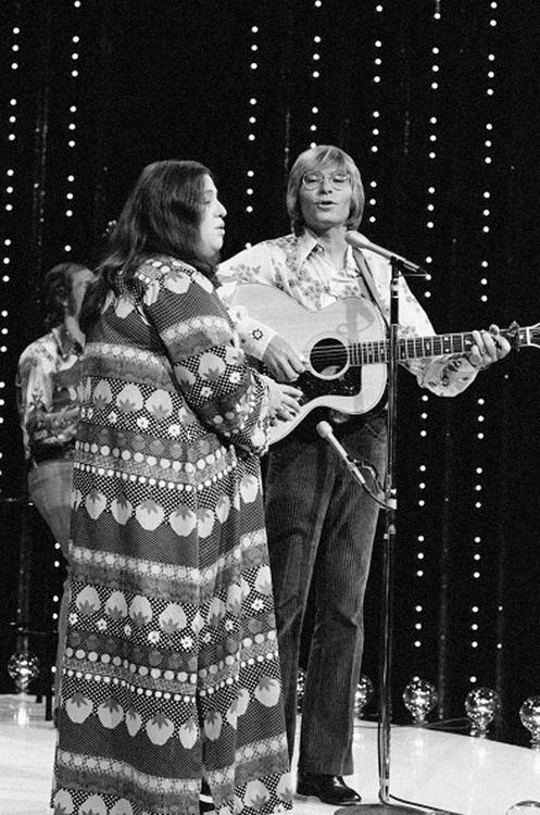 """Mama"" Cass Elliott and John Denver perform on the television show ""The Midnight Special"" - August 1972  Photo: Gary Null/NBC/NBCU Photo Bank via Getty"