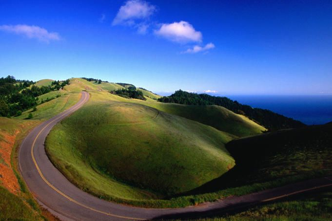 Green hills and curving road. USA