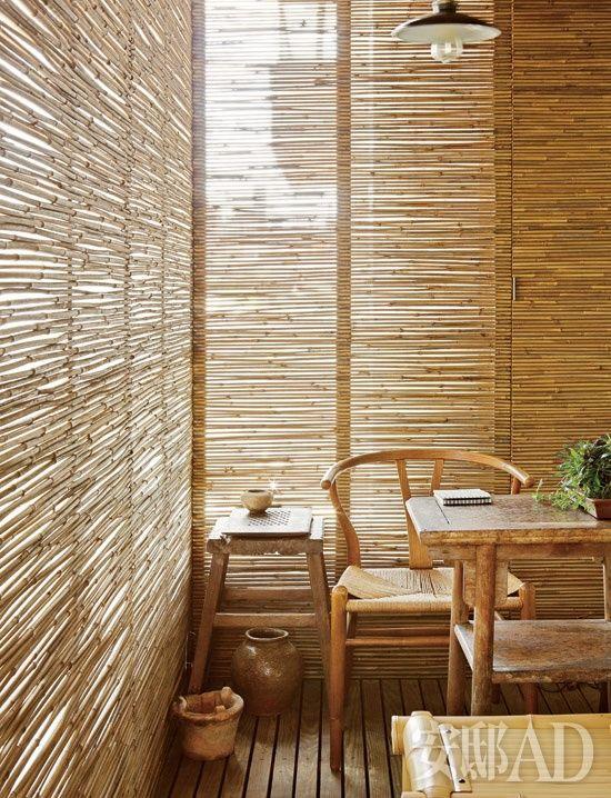 Bamboo shielding light creates an intimate nook.