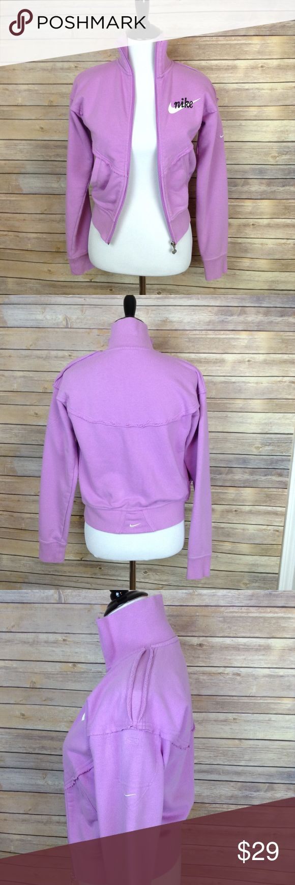 """Nike purple zip up jacket This plum colored Nike jacket certainly has a vintage feel to it! Preloved, just normal wash and wear, no stains or flaws noted, no fraying if sleeve cuffs. Terri cloth lining. Embroidered Nike logo. Swoosh logo on back waistband and left shoulder.  Split shoulder seam on left side. Front & back yoke.  This is more of a plum color according to chart.  APPROX FLAT MEASUREMENTS  21"""" ↕️ 17"""" ↔️ armpits 22"""" sleeves.  14"""" ↔️ at waistband  It says 4-6, I believe it's…"""