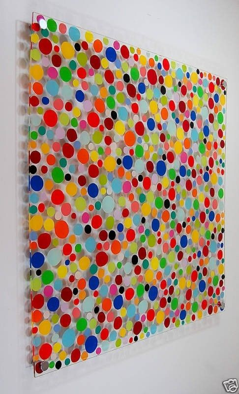 I'm not crazy about the dots, but I love the idea of paint on lucite panels mounted on the wall.