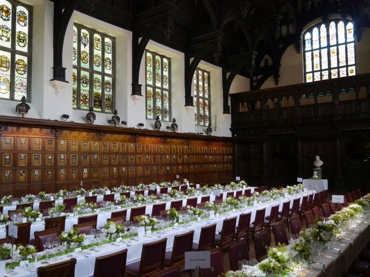 White and green flowers work perfectly with the wood paneling in Middle Temple Hall
