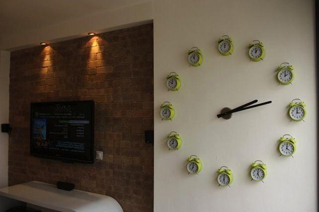 Giant wall clock from 12 alarm clocks