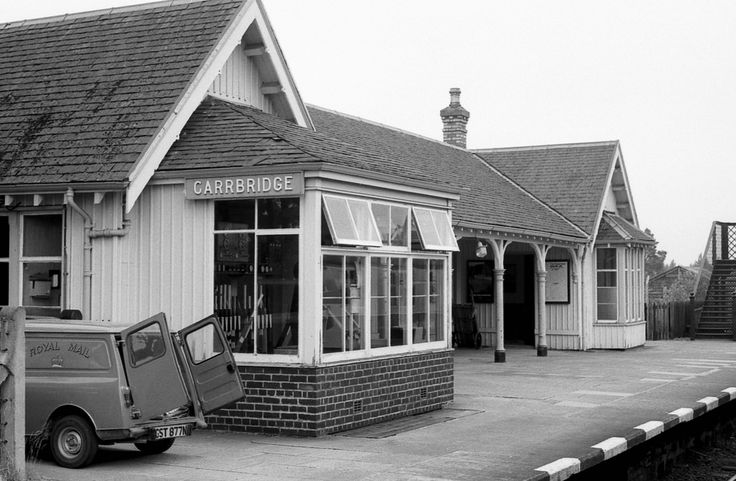 CarrBridge Station was opened in 1892 on the Highland Railway direct line from Aviemore to Inverness and is still served by trains today. I'm not sure if the signal box built into the station building still operates the semaphore signals anymore.  The 2-3 year-old Post Office Austin Minivan - GST877N - on the platform is a delightful period piece.