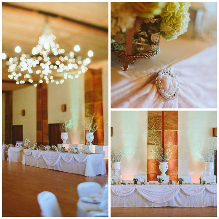 My fairy light chandeliers, pearl and lace table draping and white lace chair tie backs at my beautiful wedding venue - Stellenrust Wine Estate