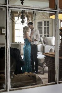 Stephen Carroll INTIMATE COUPLE IN GRAND ROOM
