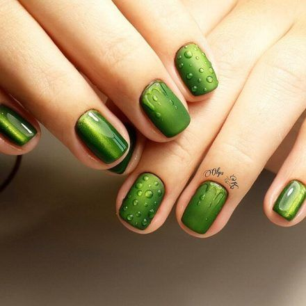 The nail design is green. Transparent gel nails imitate rain drops.