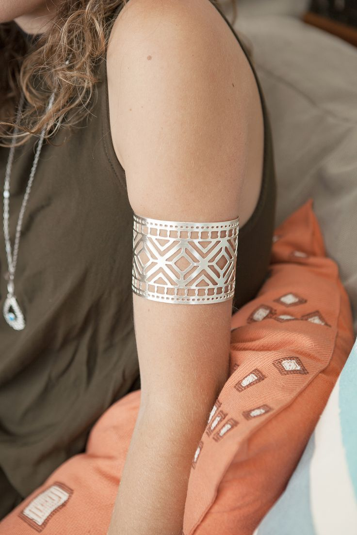 Style made fair. This striking arm cuff has been hand-made in India.