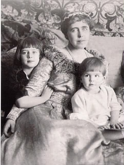 Queen Marie with a short haired Princess Ileana and Prince Mircea.