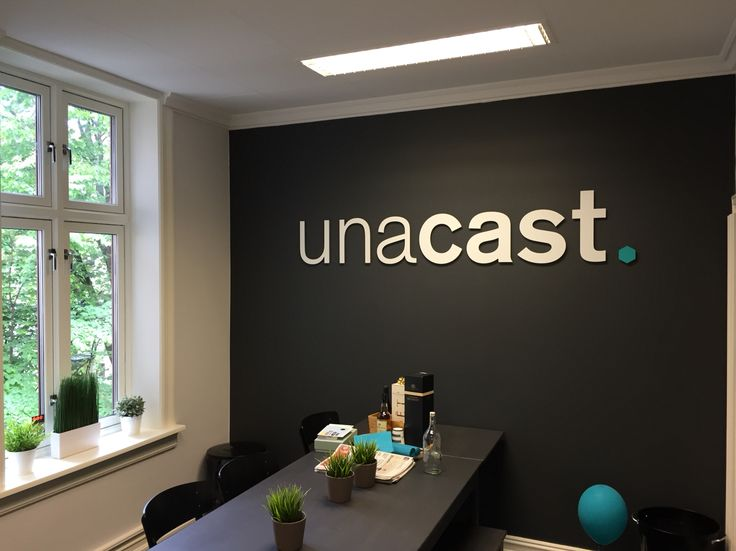 Indoor sign for Unacast office in Oslo Norway.