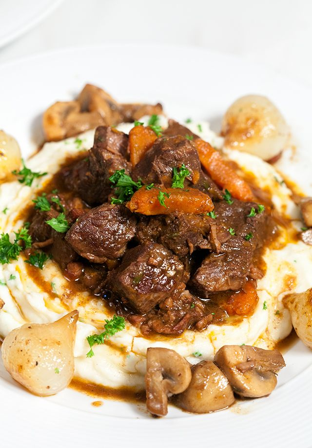 "Your Tuesday NEEDS this hearty comfort dish. Just trust me, it does. I was feeling a little Julia Child-inspired, so I decided to make her famous beef bourguignon. But, I didn't stop there, I also made her garlic mashed potatoes (which just may be the best I've had). Sooo, just FYI, this is not a meal that you can just ""whip up."" It will take hours, but it will be worth every second. Plus, it makes at least 6 servings, so you can enjoy the fruits of your labor for the whole week! For real…"