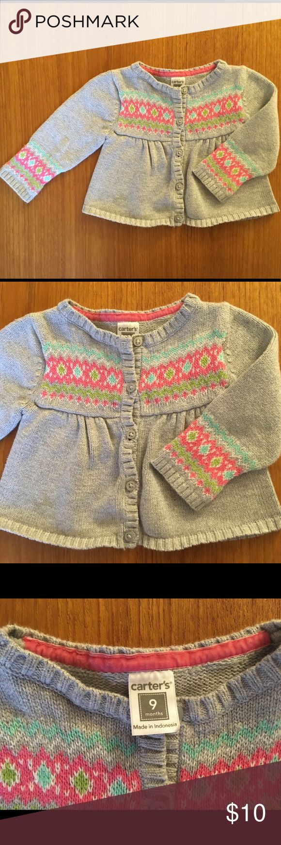 Carter's baby girl knit sweater 9mo Carter's baby girl knit sweater size 9 months. Grey in color with pink, green and blue detailing.  Button up front. Carter's Shirts & Tops Sweaters #babygirlsweaters