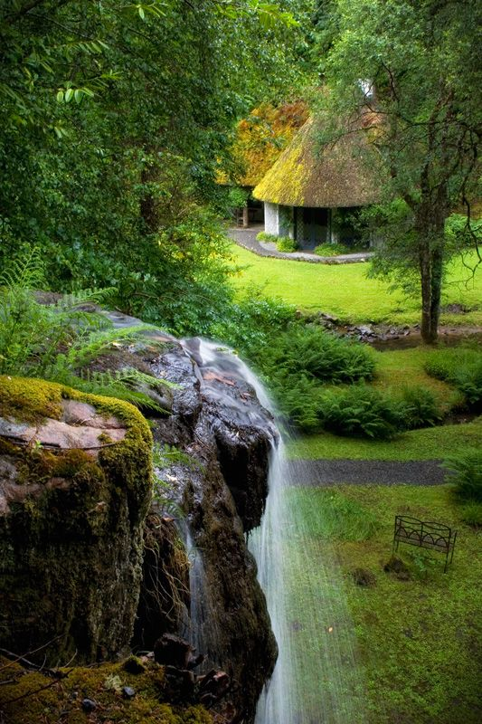 Irish cottage with waterfall.
